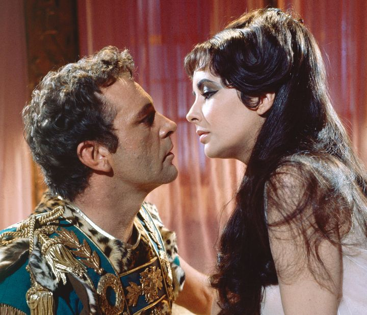 "The look of love. Liz and Richard Burton on the set of  1963's ""Cleopatra."""
