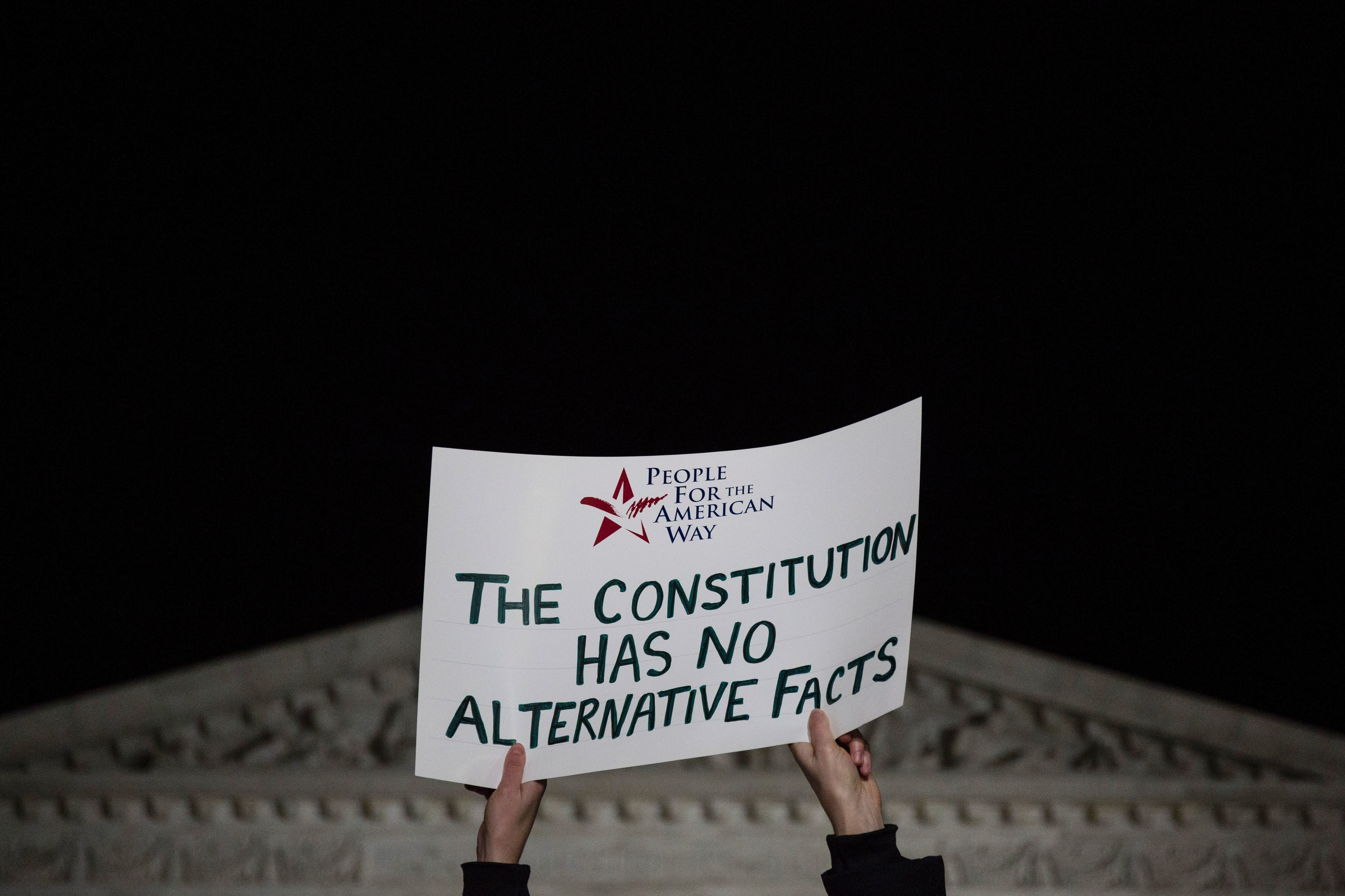 Demonstrators gather outside of The United States Supreme Court after President Donald Trump announced Neil Gorsuch as his nominee to fill the seat of former Associate Justice of the Supreme Court Antonin Scalia in Washington, DC, on January 31, 2017. President Donald Trump nominated federal appellate judge Neil Gorsuch as his Supreme Court nominee, tilting the balance of the court back in the conservatives' favor. / AFP / ZACH GIBSON        (Photo credit should read ZACH GIBSON/AFP/Getty Images)