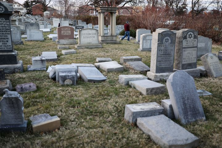 Vandalized tombstones are seen at the Jewish Mount Carmel Cemetery, Feb. 26, in Philadelphia. Police say more than 100 tombst