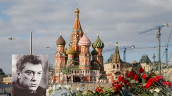A portrait of Kremlin critic Boris Nemtsov and flowers are pictured at the site where he was killed on February 27, with St. Basil's Cathedral seen in the background, at the Great Moskvoretsky Bridge in central Moscow March 6, 2015. Nemtsov, 55, was shot dead meters from the Kremlin as he was walking home. REUTERS/Maxim Shemetov (RUSSIA - Tags: POLITICS CRIME LAW)