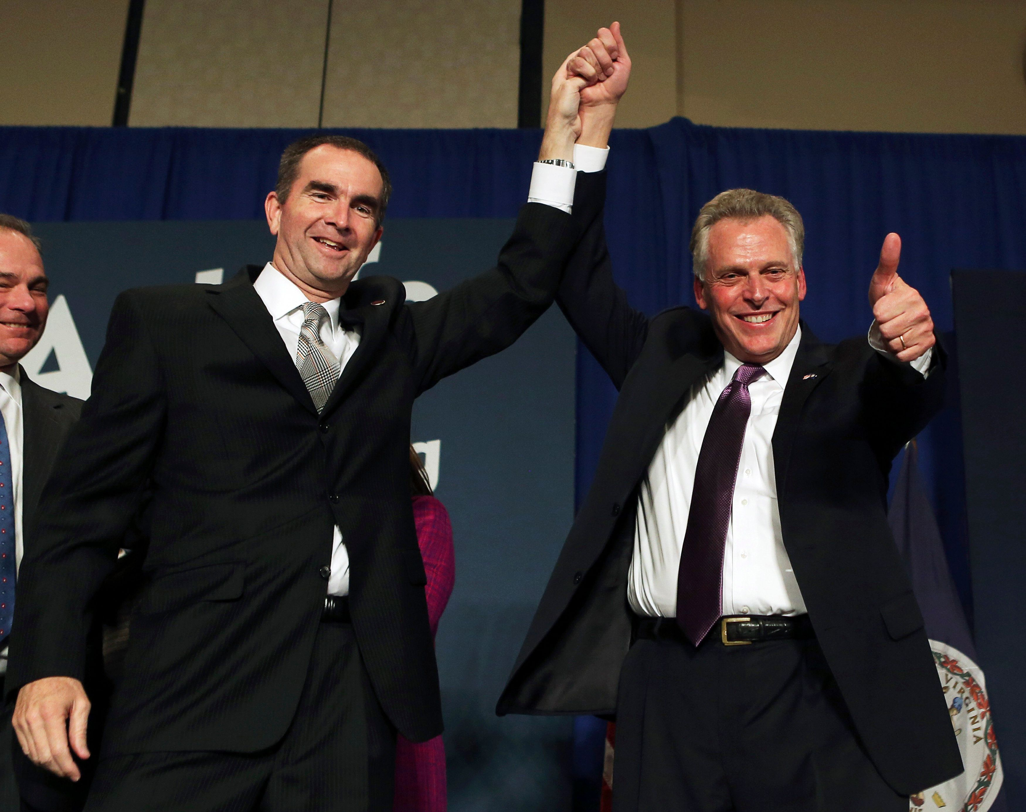 Virginia Democratic governor-elect Terry McAuliffe (R) celebrates with lieutenant governor-elect Ralph Northam (L) at their election night victory rally in Tyson's Corner, Virginia November 5, 2013. McAuliffe defeated Republican candidate Ken Cuccinelli in today's governor's election in Virginia.   REUTERS/Gary Cameron    (UNITED STATES - Tags: POLITICS ELECTIONS)