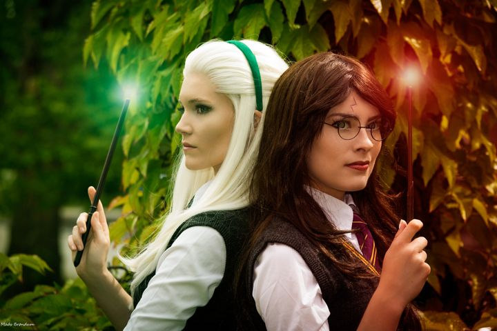 "S&oslash;rine&nbsp;(aka <a href=""https://www.facebook.com/SurineCosplay/"" target=""_blank"">Surine Cosplay</a>) as a female&nbsp;Draco&nbsp;Malfoy on the left and Carina (aka <a href=""https://www.facebook.com/RinacaCosplay/"" target=""_blank"">Rinaca Cosplay</a>) as a female Harry Potter on the right."