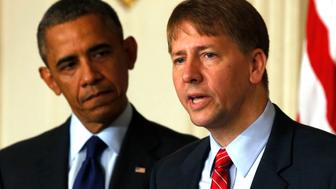 U.S. President Barack Obama (L) looks at the new Director of the Consumer Financial Protection Bureau Richard Cordray in the State Dining Room at the White House in Washington July 17, 2013. The U.S. Senate on Tuesday confirmed Cordray as director of the Consumer Financial Protection Bureau, ending a nearly two-year standoff in Congress and putting the new agency on sounder legal footing.   REUTERS/Larry Downing  (UNITED STATES  - Tags: POLITICS BUSINESS)