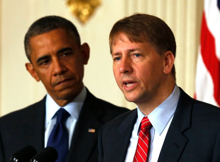 U.S. President Barack Obama (L) looks at the new Director of the Consumer Financial Protection Bureau Richard Cordray in the