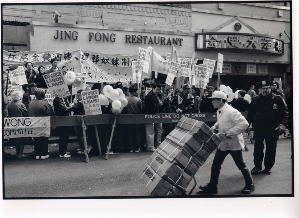 Picketing restaurant waiters and community members protest outside Jing Fong Restaurant whose management illegally took waite
