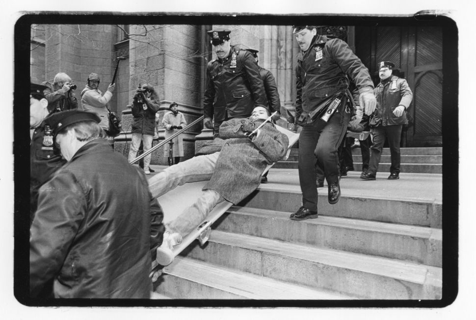 A protester is carried away during an ACT-UP Stop the Church direct action at St. Patrick'€™s Cathedral on Dec. 10, 1989. (Br