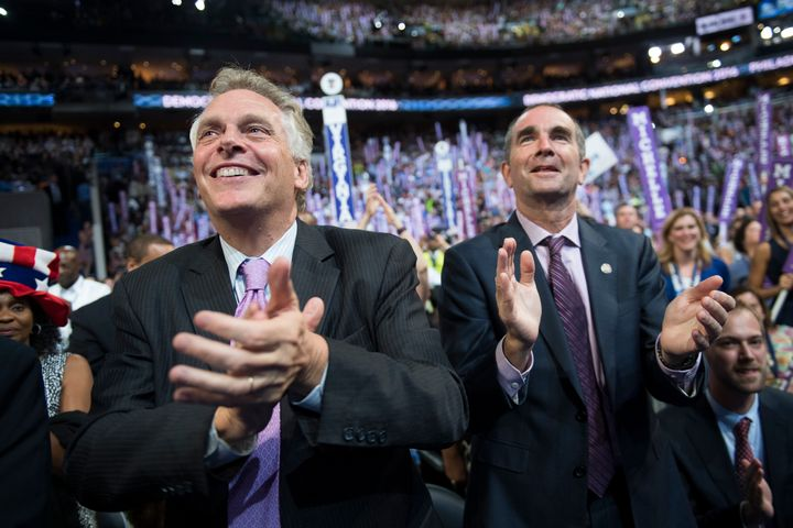 Virginia Gov. Terry McAuliffe, left, and Lt. Gov. Ralph Northam cheer on the floor of the Democratic National Convention in P