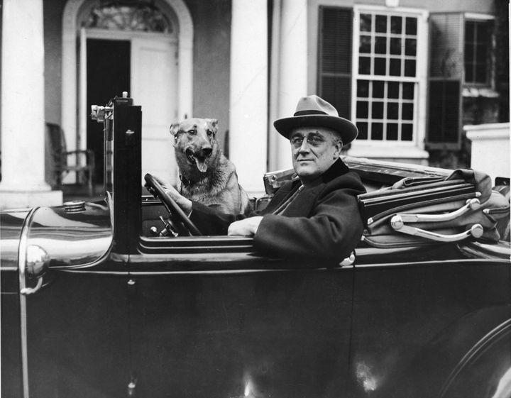 President Franklin Delano Roosevelt sits behind the wheel of his car outside his home in Hyde Park, New York, in the mid 1930