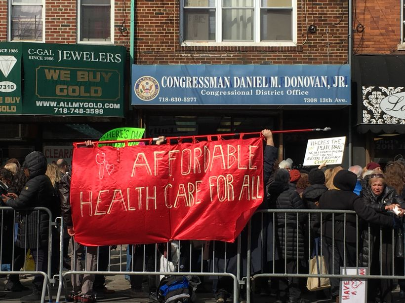 #GetOrganizedBK members contributed a huge sign to a protest demanding affordable health insurance.