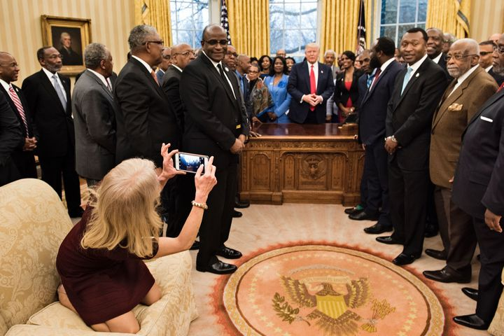 Kellyanne Conway snaps a photo from an Oval Office sofa.