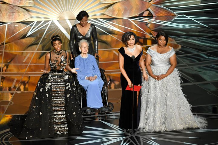 Katherine Johnson appears onstage with Janelle Monae, Taraji P. Henson and Octavia Spencer during the 89th Academy Awards.