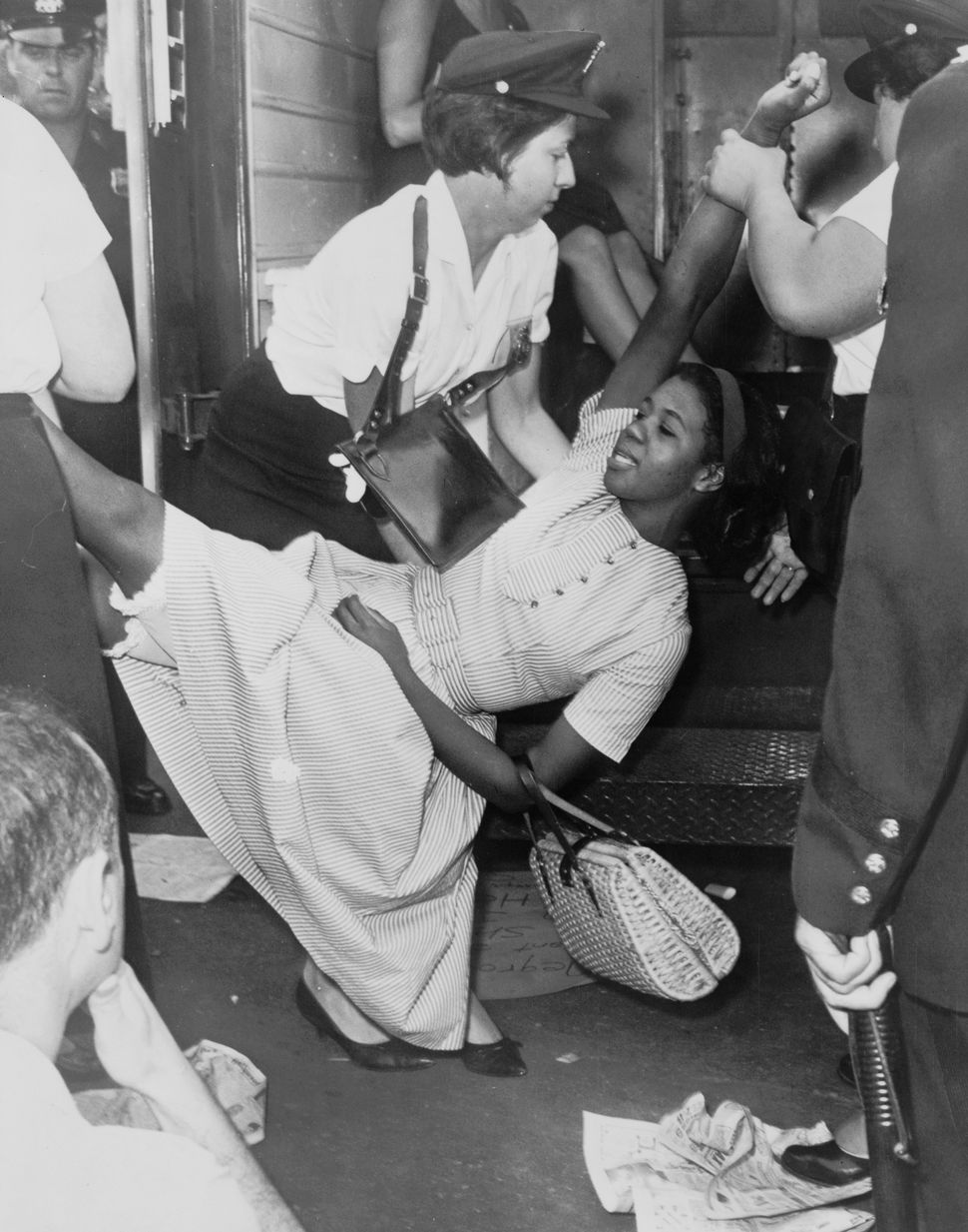 African American woman being carried to police patrol wagon during demonstration in Brooklyn, New York circa 1963.