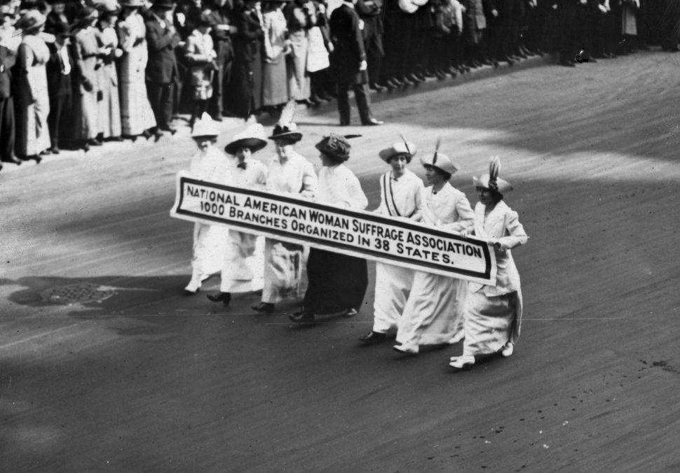 Members of the National American Woman Suffrage Association marching with a banner which publicizes their '1000 branches orga