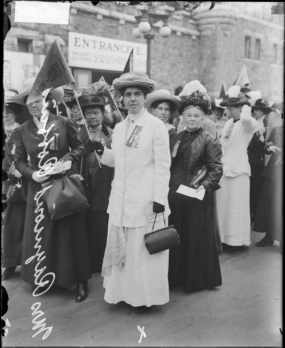Mrs Raymond Robbins and a group of women suffragists in front of the Coliseum at the time of the Republican National Conventi