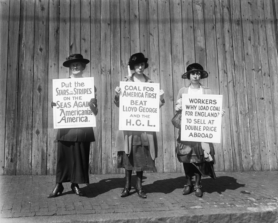Boston women pickets are centering their drive to prevent the export of coal to that England on Sep. 22, 1920. Three of the w
