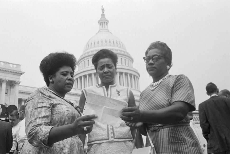 The House of Representatives met today to affirm seating of its Mississippi members, as Civil Rights demonstrators massed in
