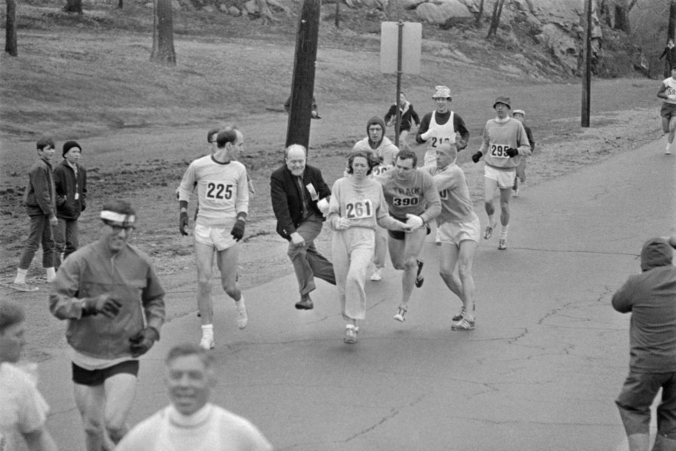 In the Boston Marathon, one of two women running in the normally all-male-race, Kathy Switzer, (261) of Syracuse, New York, i