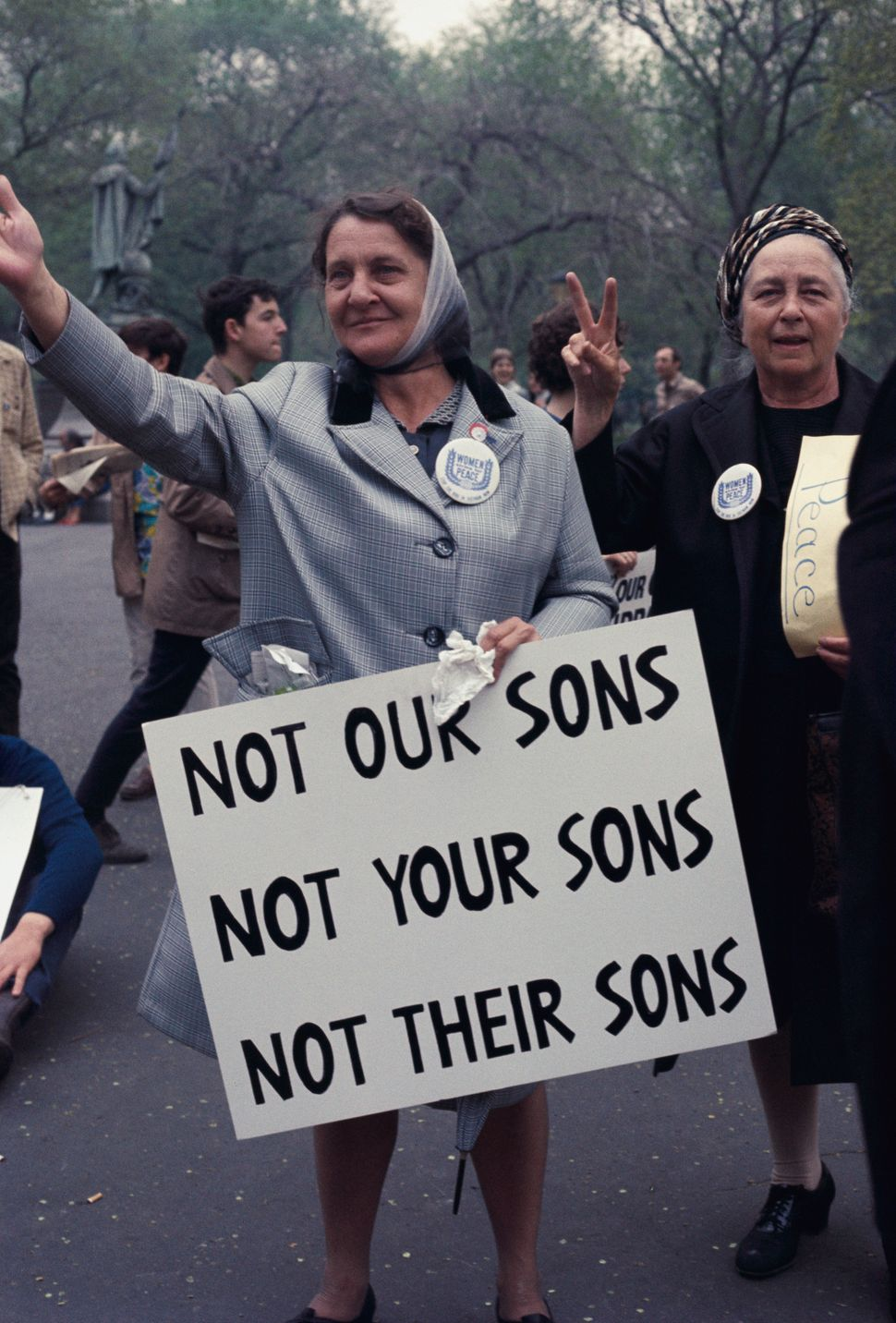Two older women making peace signs during anti-Vietnam war march on April 27, 1968.