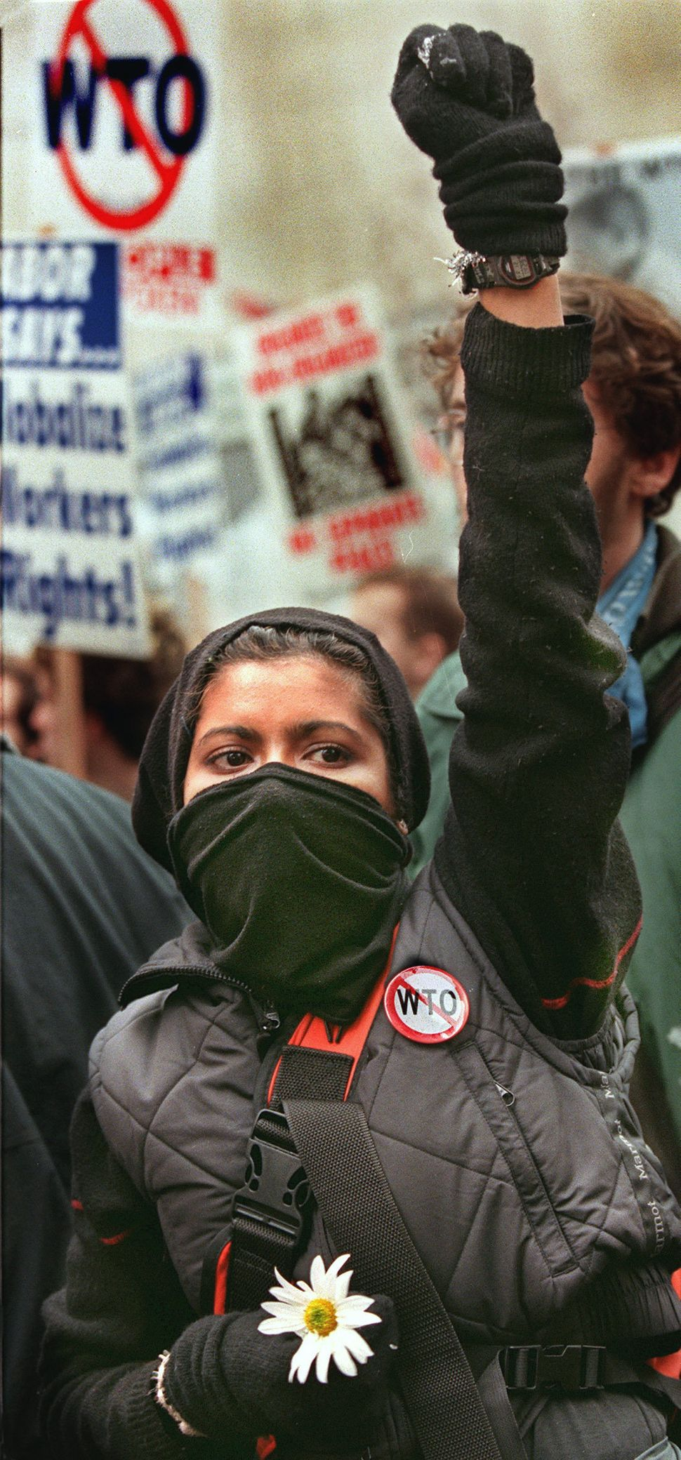 A demonstrator holds a flower that she says is a symbol of hope on Dec. 3, 1999.