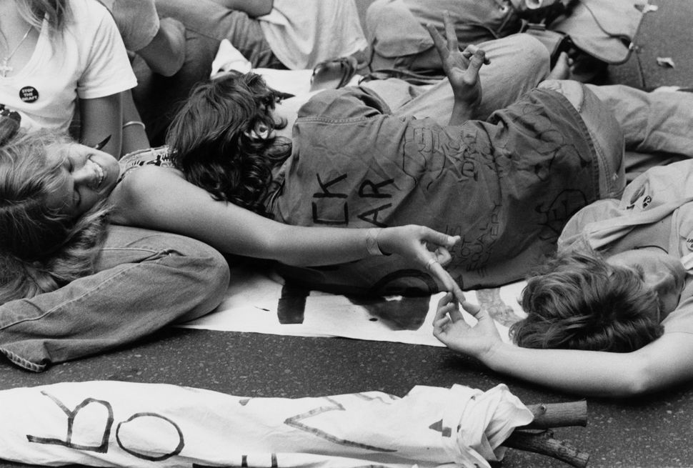 A group of young people lying down at a peace demonstration in New York City, circa 1978.