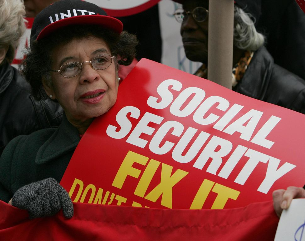 A woman holds a sign at a labor rally to protest the privatization of Social Security 31 March, 2005, in New York. US Preside