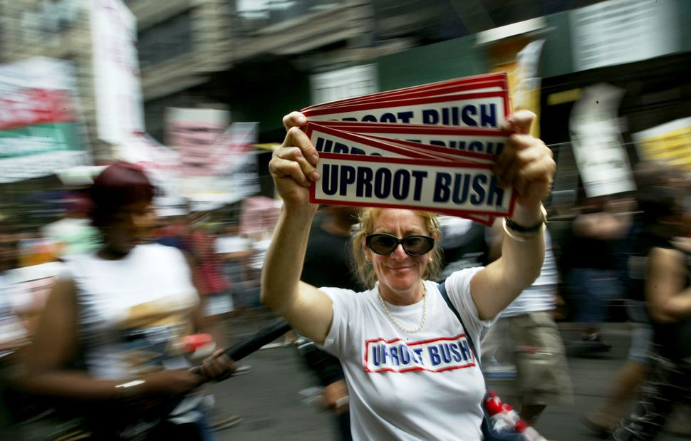 A woman displays an anti-Bush placard August 30, 2004 in New York City. Dozens of protests are scheduled during the Republica