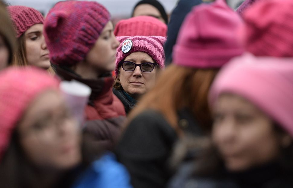 Demonstrators protest on the National Mall in Washington, DC, during the Women's March on January 21, 2017. Hundreds of thous