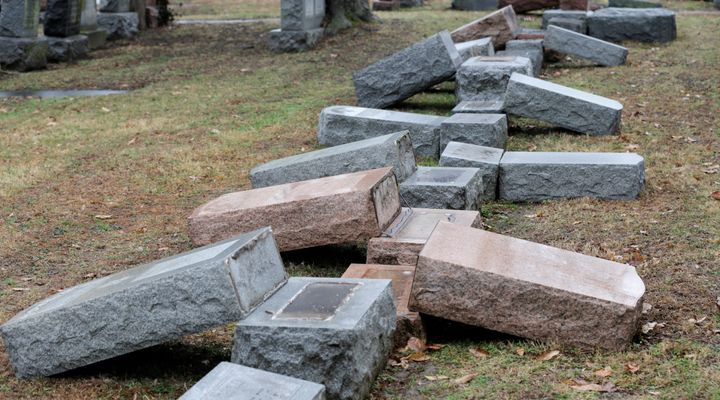 A row of more than 170 toppled Jewish headstones is seen after a weekend vandalism attack on Chesed Shel Emeth Cemetery in Un