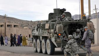 Soldiers from U.S. Army Alpha Company, 2-3 Inf, 3-2 SBCT, patrol a village with Afghan forces at the National Training Center in Fort Irwin, California, U.S. on August 13, 2011.   Courtesy Ryan Hallock/U.S. Army/Handout via REUTERS   ATTENTION EDITORS - THIS IMAGE WAS PROVIDED BY A THIRD PARTY. EDITORIAL USE ONLY