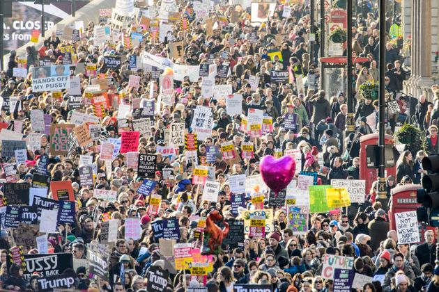 Demonstrators walk down Piccadilly during the Women's March on London, where protesters marched to promote...