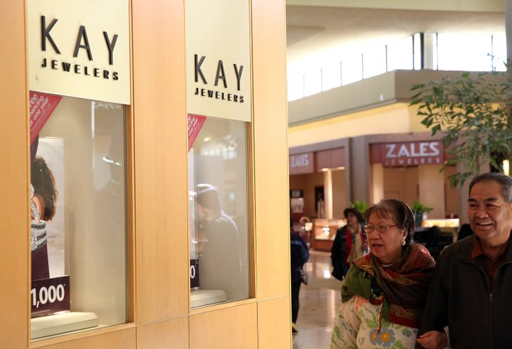 Shoppers walk by a Kay Jewelers and Zales Jewelers stores at the Serramonte Mall on Feb. 19, 2014 in Daly City, California.