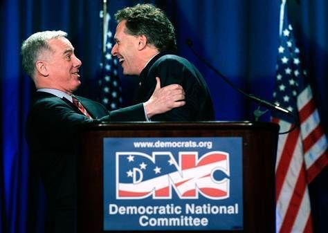 Howard Dean and Terry McCauliff, two former DNC chairs, embracing long ago.