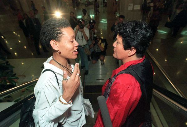 South African lesbian activist Beverly Ditsie talks with friend Rebecca Sevilla, Peruvian activist, after addressing the Unit