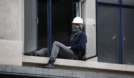 A protestor occupying the vacant UBS office in the City of London in