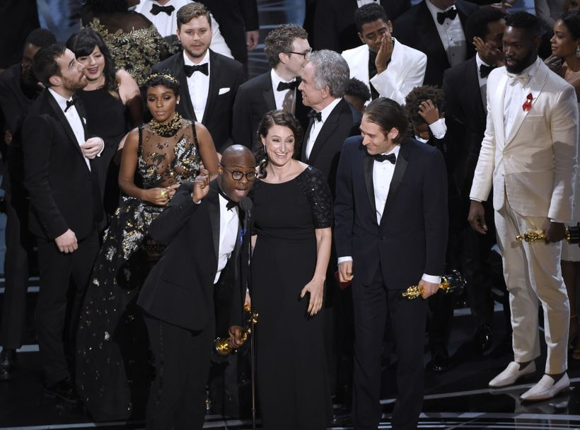 <em>Barry Jenkins, foreground left, and the cast accept the award for best picture for &quot;Moonlight&quot; at the Oscars on