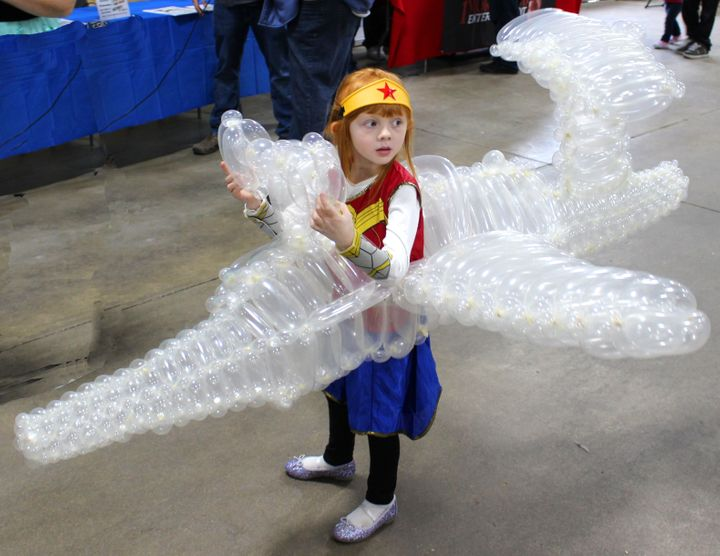 Balloon artist Marty Pants used about 275 balloons to create an invisible jet for his daughter's Wonder Woman costume.