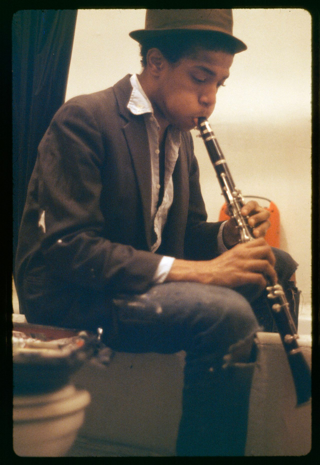 Basquiat practicing clarinet in the bathroom of the apartment, 1980.