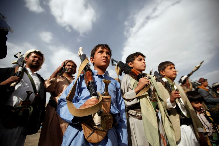 Boys attend a pro-Houthi tribal gathering in Sana'a, Yemen, on June 20, 2016.