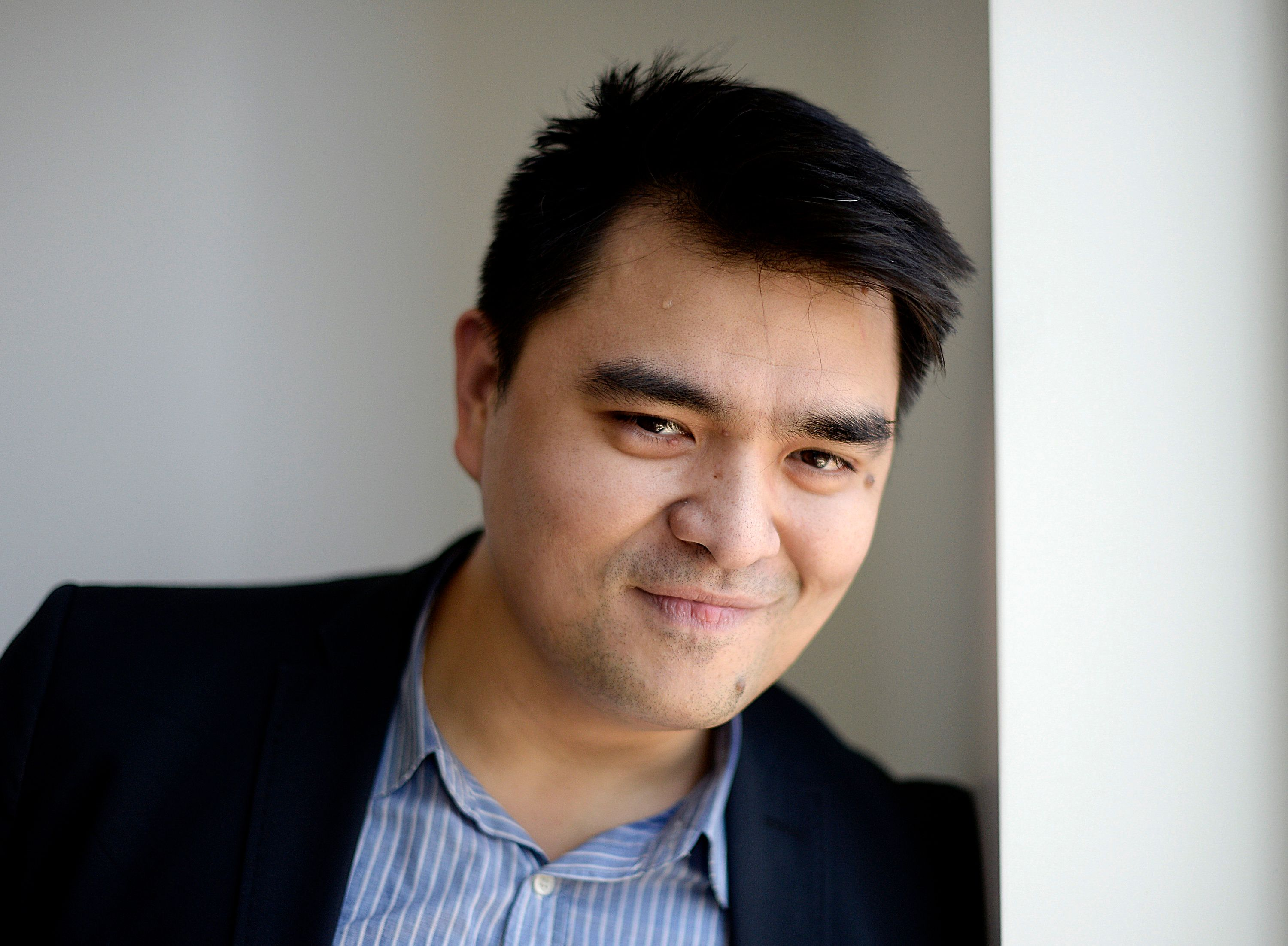 """Journalist and director of film """"Documented"""", Jose Antonio Vargas, poses for a photograph in Los Angeles, Californa June 18, 2014. In 1993 at the age of 12, Vargas said goodbye to his mother and boarded a plane in the Philippines to join his grandparents in California. It would be four more years before he would learn that he was in the United States illegally. """"Documented,"""" the debut film of the Pulitzer Prize-winning journalist Vargas, who is still without the necessary papers, premieres on U.S. cable network CNN on June 29, 2014. It tells his story growing up and working as a newspaper reporter without legal status and without a path to reverse it. Picture taken June 18, 2014. To match TELEVISION-IMMIGRATION/ REUTERS/Kevork Djansezian  (UNITED STATES - Tags: ENTERTAINMENT MEDIA PORTRAIT)"""
