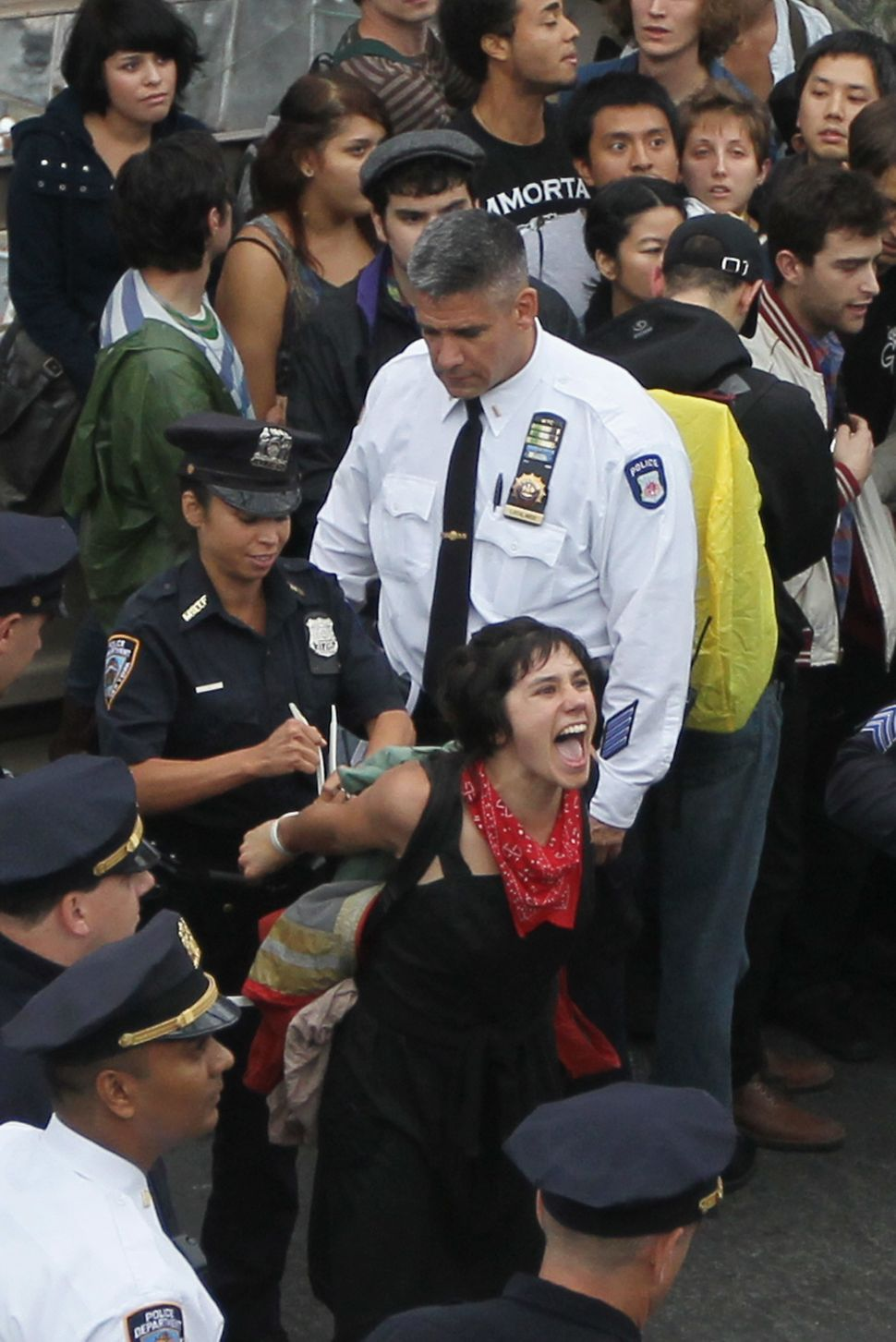 NEW YORK, NY - OCTOBER 01:   Police arrest a demonstrator affiliated with the Occupy Wall Street movement after she and fello