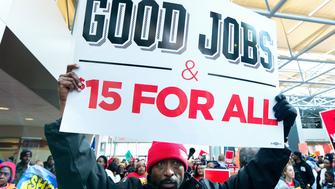 ST LOUIS, MO - FEBRUARY 13: Protesters rally against Labor nominee Andrew Puzder in the lobby of Hardee's Headquarters on February 13, 2017 in St Louis, Missouri. The protesters feel that Mr. Puzder will not have the best interest of workers in mind due to his record of being a critic of raising the minimum wage as well as expansion of overtime pay, paid sick leave and the Affordable Care Act.   (Photo by Jeff Curry/Getty Images)