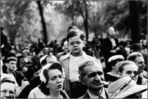 Boy above a crowd, N.Y.C., 1957.