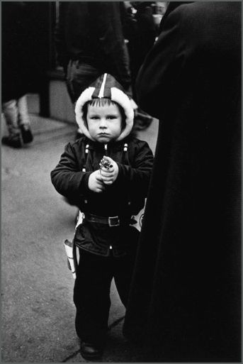 Kid in a hooded jacket aiming a gun, N.Y.C., 1957.