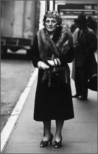 Woman in a mink stole and bow shoes, N.Y.C., 1956.