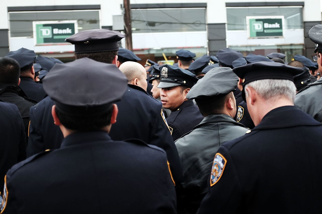 Police officers from across the country attend a funeral service for slain New York City Officer Wenjian Liu on Jan. 4, 2015.