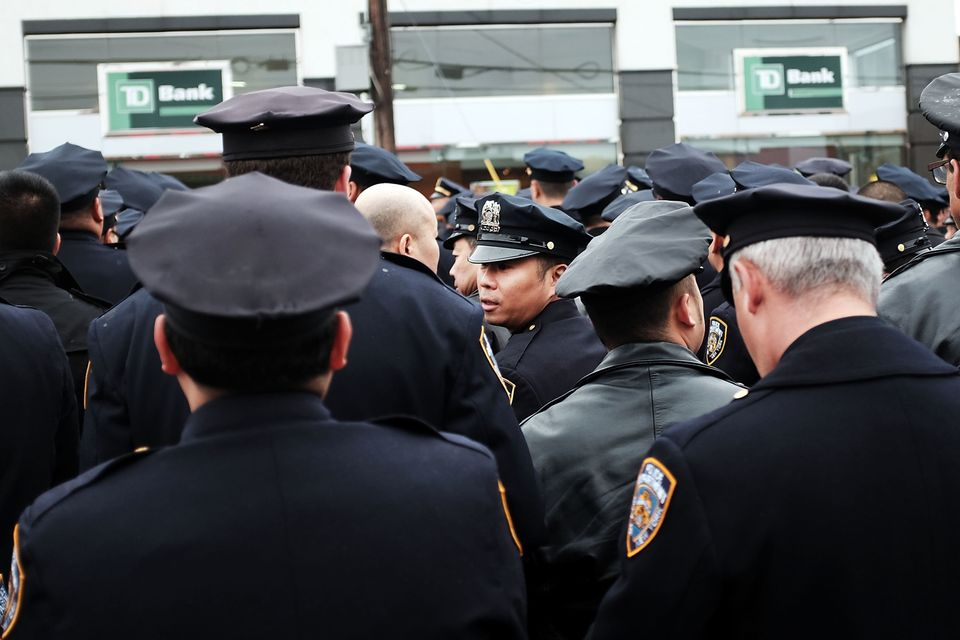 Police officers from across the country attend a funeral service for slain New York City Officer Wenjian...