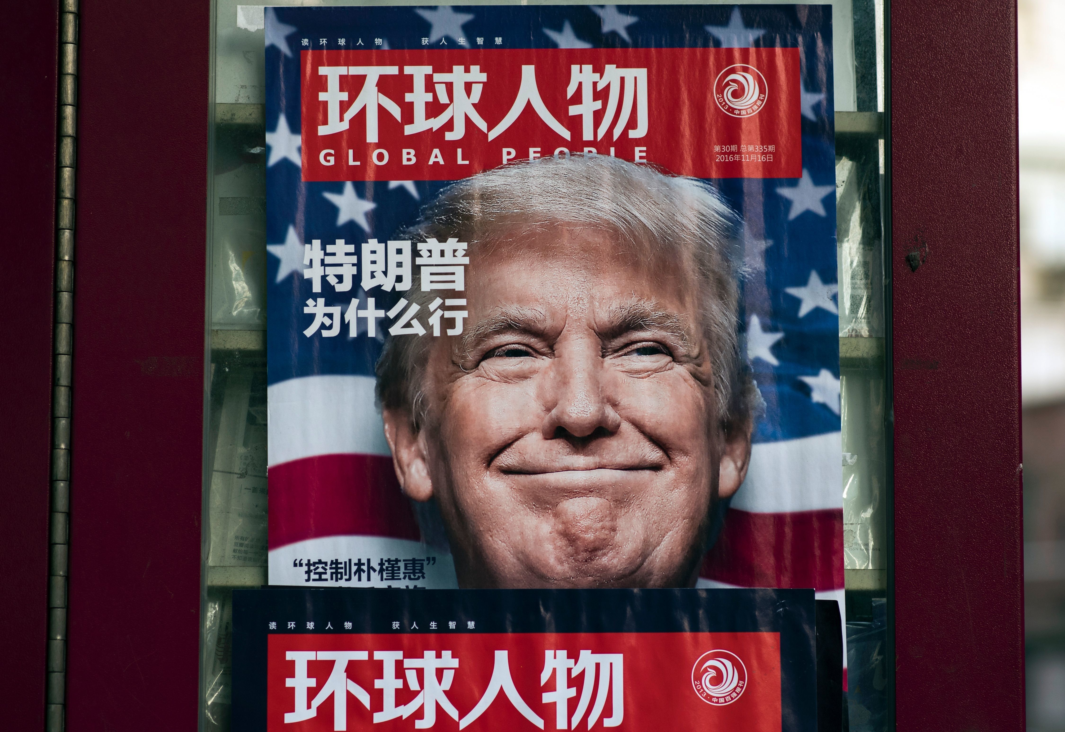 This picture taken on December 14, 2016 shows a advertisement for a magazine featuring US President-elect Donald Trump on the cover at a news stand in Shanghai. China said on December 17 it would return a US naval probe seized in international waters, as it slammed the 'hyping' of the incident as 'inappropriate and unhelpful'. The incident comes amid escalating tensions between China and the United States, with Trump repeatedly infuriating Beijing by questioning longstanding US policy on Taiwan, calling Beijing a currency manipulator and threatening Chinese imports with punitive tariffs.  / AFP / Johannes EISELE        (Photo credit should read JOHANNES EISELE/AFP/Getty Images)