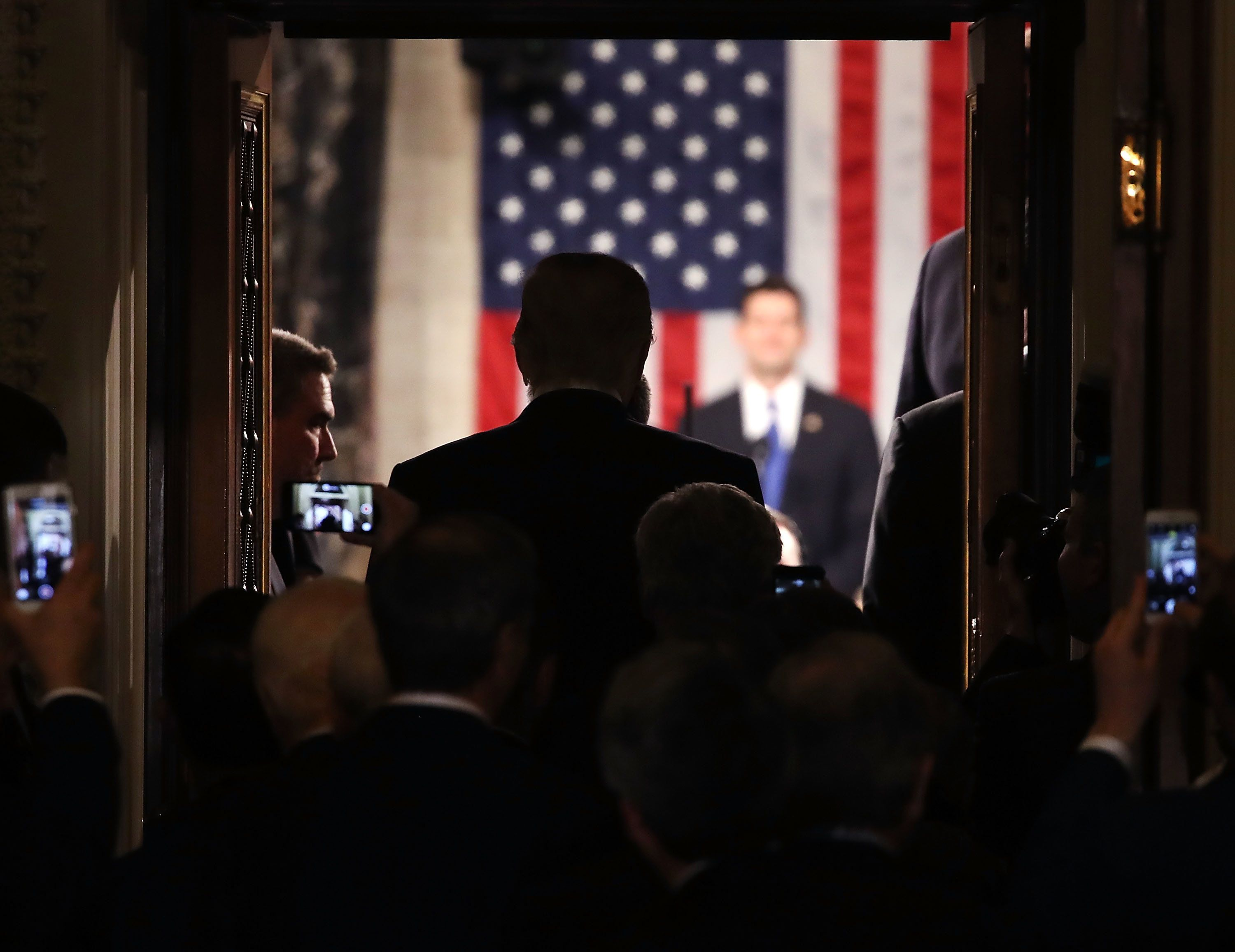 WASHINGTON, DC - FEBRUARY 28: U.S. President Donald Trump stands in the doorway of the House chamber while being introduced to speak before a joint session of Congress on February 28, 2017 in Washington, DC. Trump's first address to Congress is expected to focus on national security, tax and regulatory reform, the economy, and healthcare.  (Photo by Mark Wilson/Getty Images)