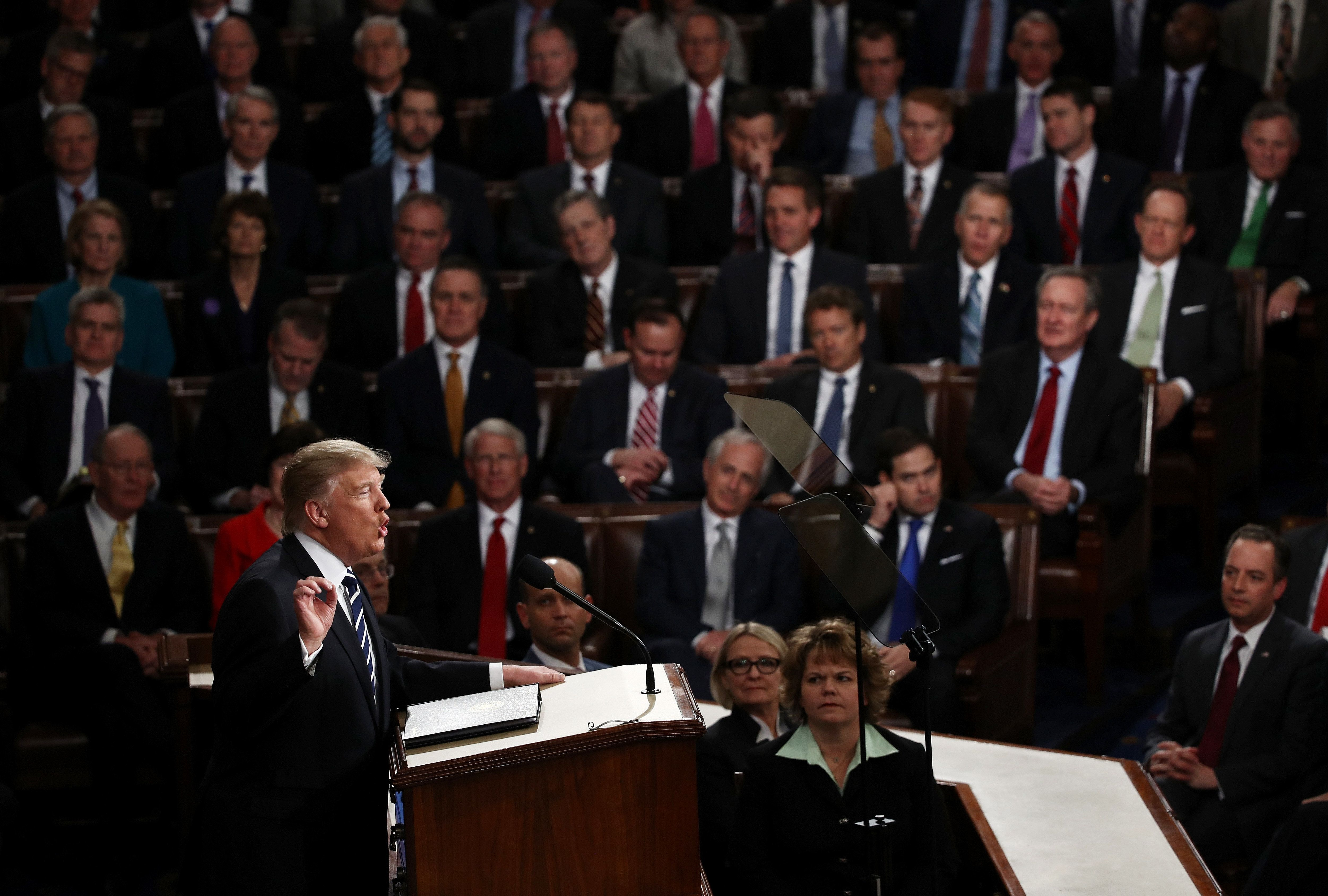 President Donald Trump arrives to addresses a joint session of the U.S. Congress on Tuesday.