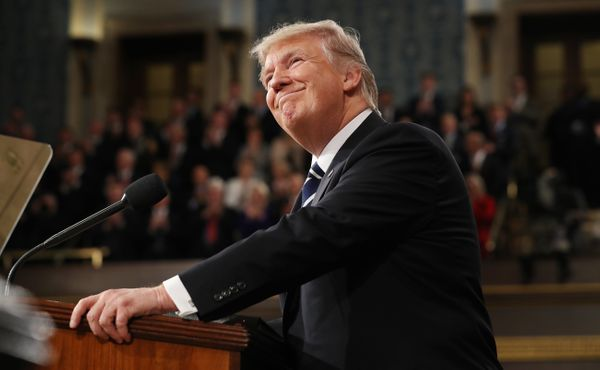 President Donald Trump arrives to deliver an address to a joint session of the U.S. Congress.